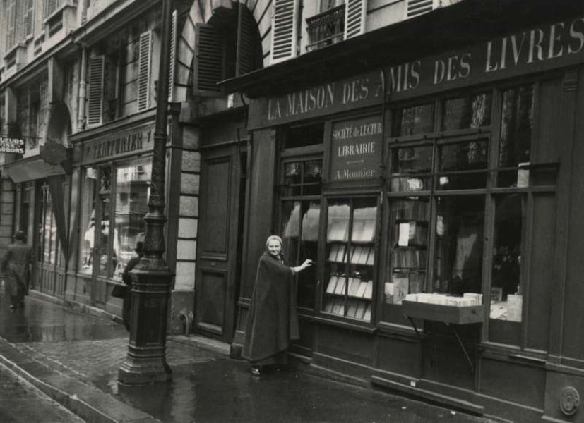 Monnier in front of bookstore